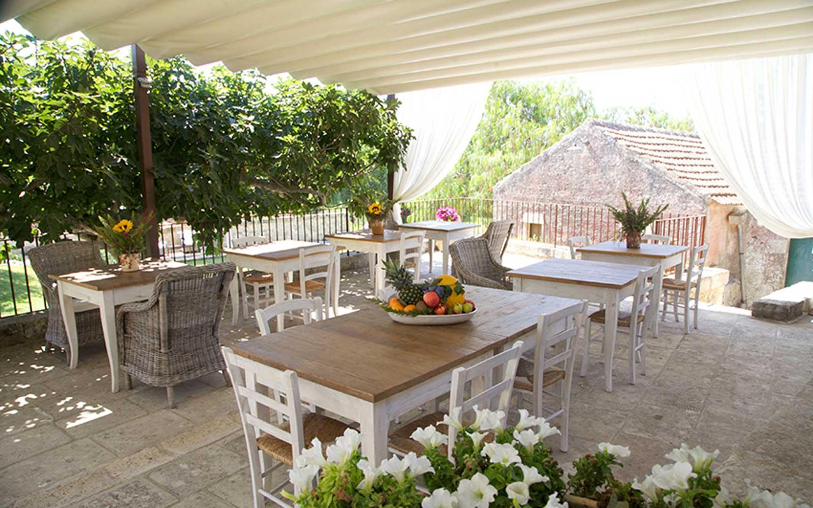 Outdoor Dining Area at Naturalis Bio Resort & Spa